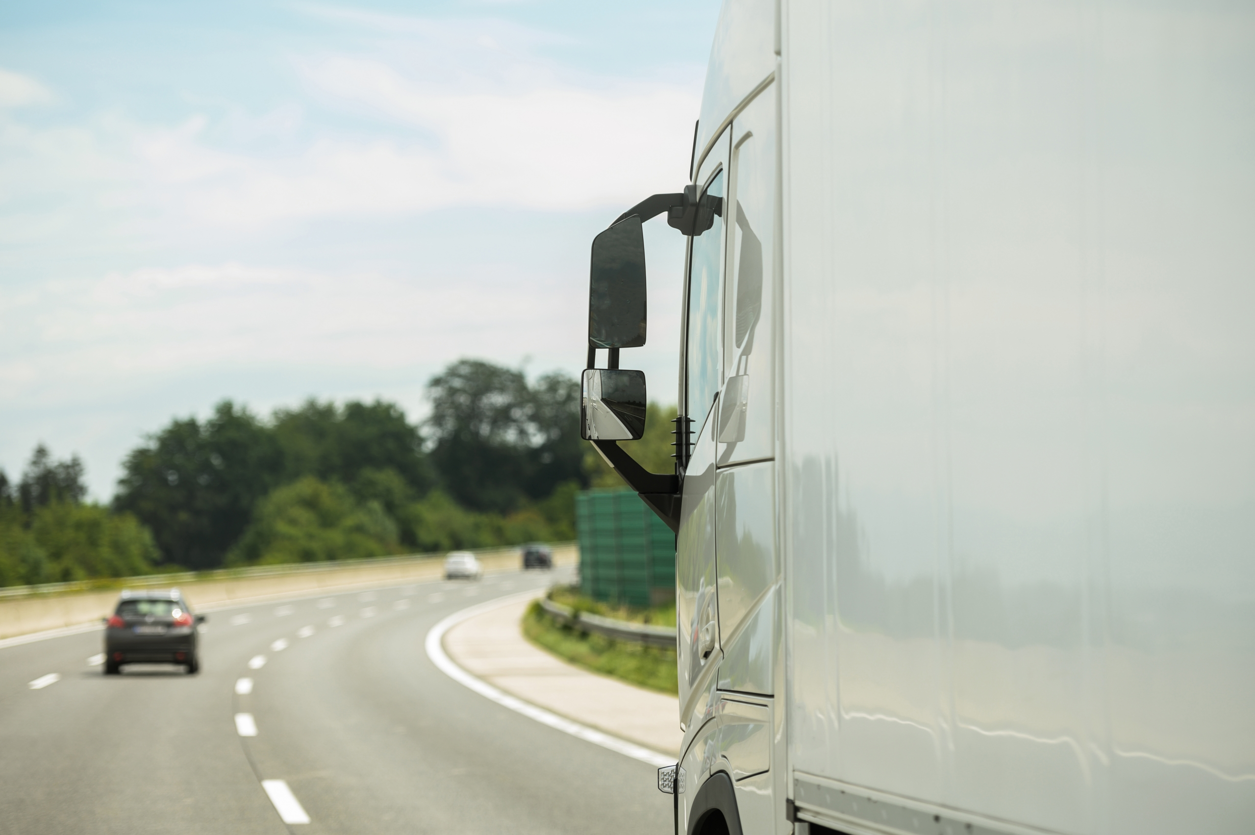 Modern Semi Truck on a Highway Right Before Strong Right Turn Curve. Transportation Industry.