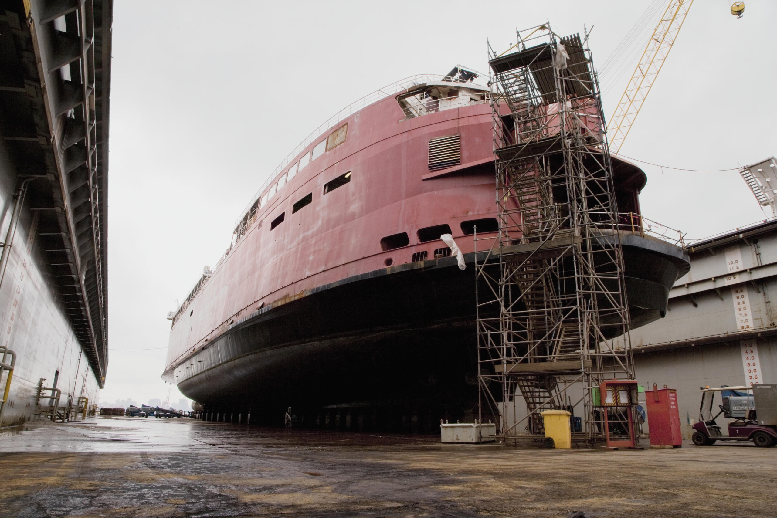 Ship on Dry Dock, a large vessel beached for repair out of the water