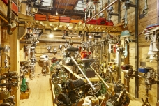 Classic yacht motor collection on a wooden warehouse indoor. Vertical